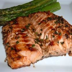 Grilled Salmon II Recipe - Salmon fillets are marinated in an Asian inspired sweet and spicy marinade before grilling.