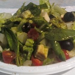 Green Salad with Dried Mint Recipe - This ultra easy, wholesome salad uses dried mint in an olive oil dressing with avocados, hearts of palm, black olives, cherry tomatoes, and cucumber. Choose iceberg, romaine, or butter lettuce for the greens.
