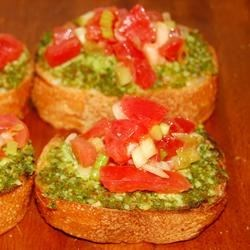 Bruschetta II Recipe - A little French ...a little Italian ...and the end result is a sensational appetizer. A scrumptious spinach/basil pesto is whirled in the food processor until of spreading consistency. Slices of baguette are lightly toasted and then anointed with the pesto.