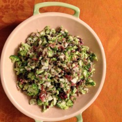 Bacon Broccoli Salad with Raisins and Sunflower Seeds Recipe - This smoky, crunchy broccoli salad has a tangy and sweet mayonnaise-based dressing. It's sure to be a family favorite.