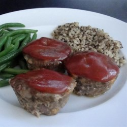 Meat-Lover's Cupcakes Recipe - Kids and adults alike love these meatloaf 'cupcakes' topped with a Dijon mustard sauce and Cheddar cheese.