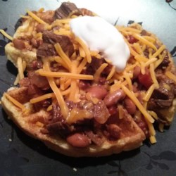 Trina's Beef Brisket Chili with Cornbread Waffles Recipe - A richly flavored, smoky chili full of cooked beef brisket and beans is served over hot cornbread waffles for a filling and tasty meal great for a cold day.