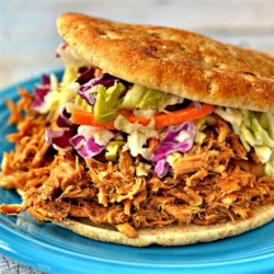 Pulled Pork Ya'll Recipe - Pulled pork in a perfectly seasoned sauce is made in the slow cooker for an easy meal for potlucks or weeknight dinner.