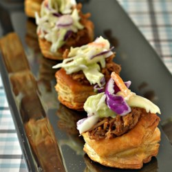 Pulled Pork and Coleslaw Bundles Recipe - These flavor-packed bundles feature Pepperidge Farm(R) Puff Pastry Shells baked until golden and filled with prepared pulled pork and a touch of creamy coleslaw.