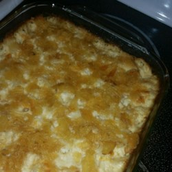 Cheezy Potatoes Recipe - This easy to make casserole is packed with potatoes and Cheddar cheese. It's a perfect side dish for any Thanksgiving table.