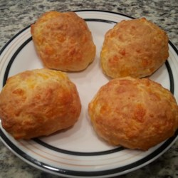 Cheddar Cheese Muffins Recipe - This muffin recipe yield nice, bread-like Cheddar cheese muffins which are not overly cheesy, but can handle an increase in the cheesy level.