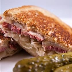 Reuben Sandwich II Recipe - These sandwiches are really delicious and easy to make. They are one of my family's fix-it-quick favorites. I like to serve them with big bowls of steaming vegetable soup and dill pickles on the side. Enjoy!
