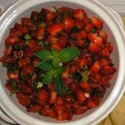 Betty Baker's Strawberry Salsa Recipe - Strawberries, grape tomatoes, and minced jalapeno pepper make a fruity, spicy salsa perfect for summer dipping.