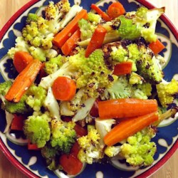 Roasted Carrots and Cauliflower with Thyme Recipe - Roasted carrots and cauliflower with thyme are tossed in Parmesan cheese creating a warm and hearty side dish for cold evenings.