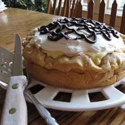 Cream Puff Cake Recipe - Like a giant eclair. Filled with creamy cream cheese cream filling, and drizzled with chocolate syrup.