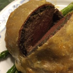 Individual Beef Wellingtons Recipe and Video - This is a particularly elegant way to serve a popular dinner-party entree of filet steaks wrapped in puff pastry, and saves carving at the table.