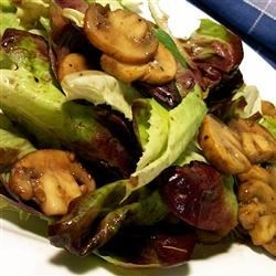 Warm Mushroom Salad Recipe - This is a warm salad: cooked mushrooms poured over mixed greens. The warm mushrooms are supposed to wilt the lettuce a bit.