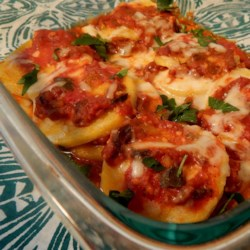 Cheesy Polenta Casserole Recipe - This rich and filling casserole uses prepared ingredients, so it comes together quickly. Sliced polenta, marinara sauce, and a blend of Italian cheeses are layered together, then browned in the oven, delicious!