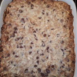 Mona's English Toffee Cookie Bars Recipe - English toffee cookie bars layered with chocolate, almonds, and sweetened condensed milk are easy to prepare and will be gone in minutes!