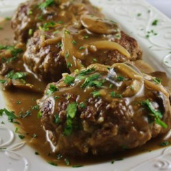 Midwest Salisbury Steak Recipe - This Salisbury steak recipe uses ground sirloin to get a leaner, meatier-tasting main dish with enough mushroom and onion gravy to top your sides, too.