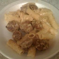 Fettuccini Alfredo With Sausage Recipe - A luscious sauce of butter, heavy cream and Locatella or Parmesan cheese is made hearty with sweet Italian sausage. Served over fettuccini noodles, this recipe makes two large or three small servings.