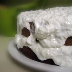 Coconut Sour Cream Cake Recipe - A simple white cake with a sour cream coconut frosting. A light, refreshing dessert.