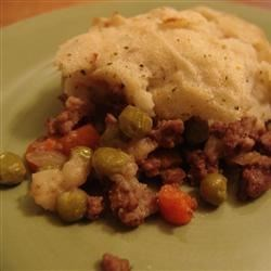 Shepherd's Pie I Recipe - Saute ground beef, chopped onion and crushed tomatoes together, until the meat is browned and the juices are absorbed. Pile the mixture into a casserole dish, and top it with mashed potatoes and grated Cheddar cheese. Ten minutes in a hot oven melts the cheese and warms the potatoes.