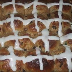 Hot Cross Buns II Recipe - This heartier version of the Easter classic includes whole wheat flour and honey, and replaces cinnamon with nutmeg.  Candied citrus peel is a delightful addition.