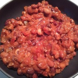 The Herd's Tailgate Chili Recipe - Ground beef, onions, peppers, garlic, and a hearty mix of beans are combined with a tomato base to create this simple and hearty chili that's perfect for tailgating.