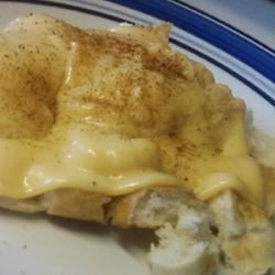 Real Welsh Rarebit Recipe - Serve this creamy and cheesy sauce over toasted bread or English muffins for a traditional Welsh meal that can be made fairly quickly.