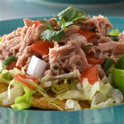 Clamato(R) Tuna Tostadas Recipe - Chopped fresh veggies are tossed with a seasoned tuna mixture and served on freshly-baked tostadas.