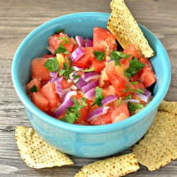 Watermelon and Pineapple Salsa Recipe - This simple, light, and refreshing salsa features watermelon, pineapple, and orange juice. Serve with tortilla chips.