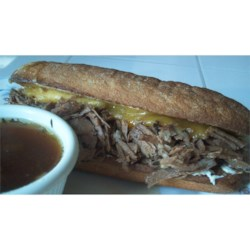 French Dip Sandwiches Recipe - This sandwich is enjoying a renaissance, in slow-cooked versions. Here, soy sauce, rosemary, and thyme add depth of flavor to the broth that develops over 10 to 12 hours of cooking.