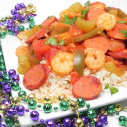 Andouille, Shrimp, and Chicken Jambalaya Recipe - Get ready for a Mardi Gras dinner for the whole family using this recipe to get a big pot of the classic sausage, shrimp, chicken, and rice dish.