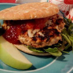 Brittany's Turkey Burgers Recipe - These turkey burgers for the grill are given a bit of sweetness from red pepper jelly, barbeque sauce, and apple. A spicy mango chutney brings a touch of heat.