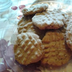 Almond-y Peanut Butter Oatmeal Cookies Recipe - Peanut butter oatmeal cookies with a hint of almond are a new twist on the classic peanut butter cookie recipe.