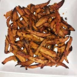 Tangy Sweet Potato Fries Recipe - These baked sweet potato wedges that are tossed in tangy Italian dressing will have your family begging for more.