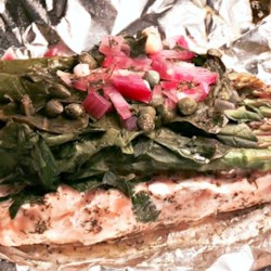 Salmon and Asparagus in a Bag Recipe - This is a fun and easy way to prepare salmon fillets. Simply fill a foil oven bag with salmon, vegetables, lemon juice, and dill, and bake for 30 minutes for an elegant dinner any night of the week.