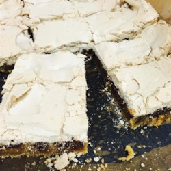 Chocolate Tom Thumb Bars Recipe - Rich, moist, chocolaty bars topped with a sweet meringue topping.