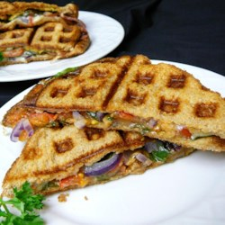Waffle Sandwich with Cheese, Spinach and Spicy Mustard Recipe - Layer all the ingredients for a fancy grilled cheese into a waffle iron for a panini-style waffle sandwich.