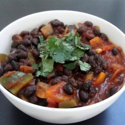 'Anything Goes' Easy Black Beans Recipe - This simple and versatile preparation of black beans with jalapeno, garlic, and onion can be served in tortillas, with scrambled eggs, on rice, or just by itself.