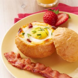 Cheesy Egg-in-a-Bowl Recipe - Wow the morning crowd with a cleverly delicious way to get savory bacon, hot cooked egg and toast in every bite.