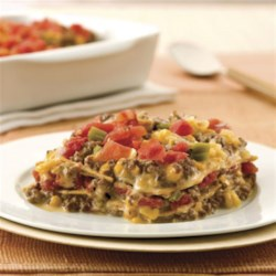 Mexican Style Lasagna Recipe - Add a kick to your lasagna with salsa and bubbly Mexican-inspired Velveeta--and join the many reviewers who are raving about this crowd-pleaser.