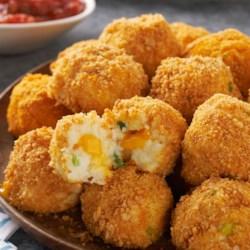 VELVEETA(R) Potato Bites Recipe - Crunchy, popable potato balls with an ooey gooey, cheesy center. Seriously. As if game day isn't enough fun already.