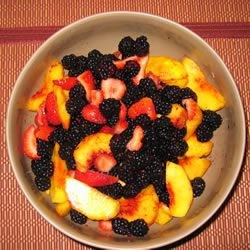 Peach and Berry Salad Recipe - This is a very elegant and lovely dessert  - fresh sliced, peaches, hulled strawberries and blackberries mingled with honey and ground cardamom.