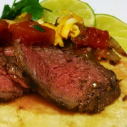 Beef Fajitas Recipe - Marinated New York steak makes a terrific beef fajita. Serve it warm white corn tortillas, salsa, and Mexican cheeses.