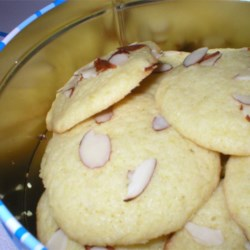 Lemon Chewy Crisps Recipe - Great fresh lemon taste in a chewy little cookie with a nice crisp brown edge.  If you don't have the almonds, you can substitute 1/4 cup additional sugar instead.