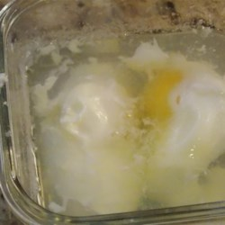 Easy Microwave Poached Eggs Recipe - Poached eggs made in the microwave is a very quick and easy way to poach eggs in about 5 minutes.