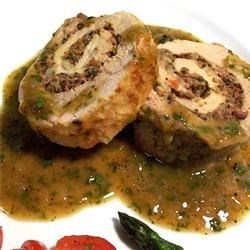 Pan Roasted Pork Tenderloin with a Blue Cheese and Olive Stuffing Recipe - Pork tenderloins are pounded flat, spread with olive tapenade, and blue cheese, then rolled up and roasted. A Dijon-lemon sauce finishes this elegant dish. Your guests will surely be impressed!