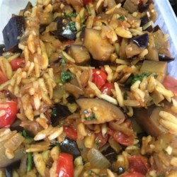 Eggplant with Almonds Recipe - This eggplant is great served as a side dish, or as a complete meal atop bulgur wheat, or couscous. It's a savory and sweet Mediterranean dish. The almonds are a nice source of protein for vegetarians.