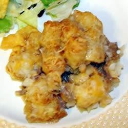 Tater Tot Casserole III Recipe - This hearty favorite with ground beef, mushroom soup, French-style green beans and tater tots will please the whole family.