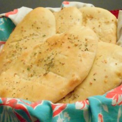Noni Afghani Recipe - This is an easy bread recipe that results in a soft, tender flat bread. My native Afghani friend says that this bread tastes better than the traditional Arabic bread she buys at the store. Enjoy!