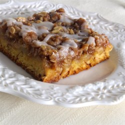 Cinnamon Roll Apple Crisp Recipe - Cinnamon roll dough is the crust in this sweet apple crisp that is topped with icing for a decadent dessert for Thanksgiving or Christmas.