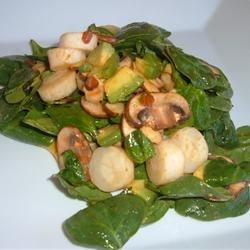 Hearts of Palm and Spinach Salad Recipe - This fresh and different salad combines spinach leaves with hearts of palm, creamy avocado pieces, tomatoes, and mushrooms. Served with a sweet and spicy vinaigrette.