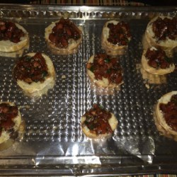 Nikol's Garlic Bruschetta Recipe - This bruschetta features toasted sourdough, topped with garlic herb cheese spread and lightly marinated tomatoes.